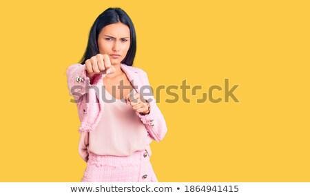 öfkeli · genç · kadın · bakıyor · el · gülümseme - stok fotoğraf © pablocalvog
