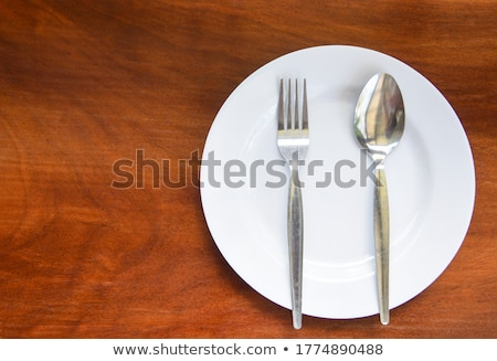 Serving spoon stainless steel on wood Stock photo © backyardproductions