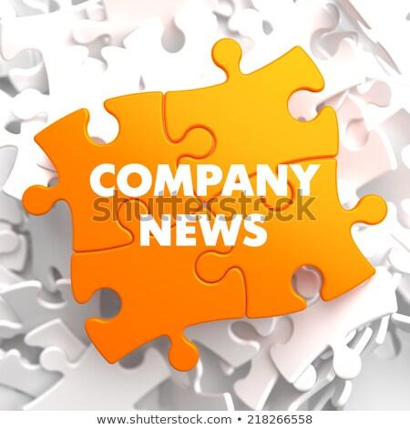 Companhia notícia laranja quebra-cabeça branco jornal Foto stock © tashatuvango