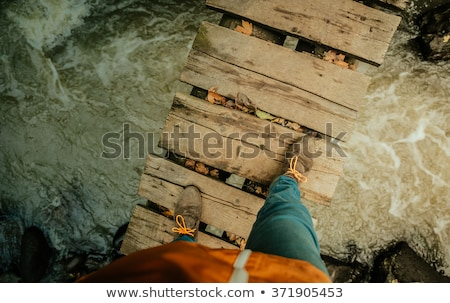 High rope bridge over the river Stock photo © BrunoWeltmann