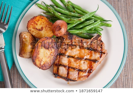 cerdo · chuleta · tabla · de · cortar - foto stock © digifoodstock