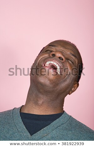 vertical image of laughing man in sweater stock photo © deandrobot