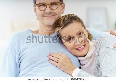 happy woman leaning on her man's shoulder Stock photo © feedough