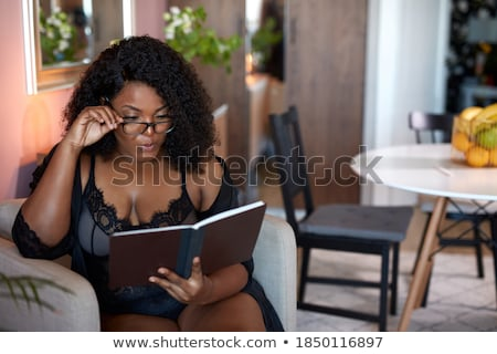 брюнетка женщину белье сидят кровать спальня Сток-фото © dmitriisimakov