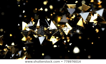 Abstract background with golden pyramidal particles Stock photo © SmirkDingo