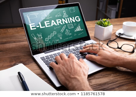 Person Using Laptop Showing E-learning Concept Stock photo © AndreyPopov