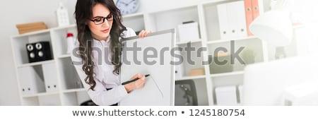 Gyönyörű fiatal lány irodai asztal mágneses jelző tábla Stock fotó © Traimak