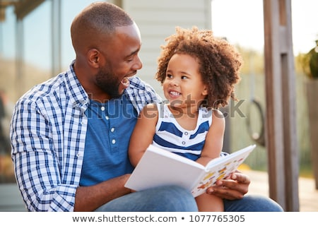 parents reading children a book stock photo © bluering