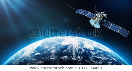 Space satellite orbiting the earth on a background star sun. Stock photo © cookelma