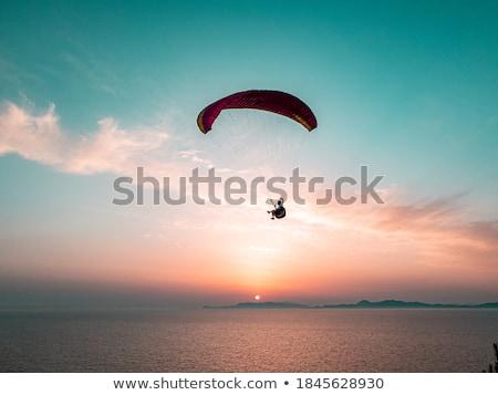 Adam paraşüt örnek bulutlar spor uçak Stok fotoğraf © adrenalina