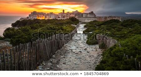 sunset and storm over the old town of bonifacio stock photo © lightpoet