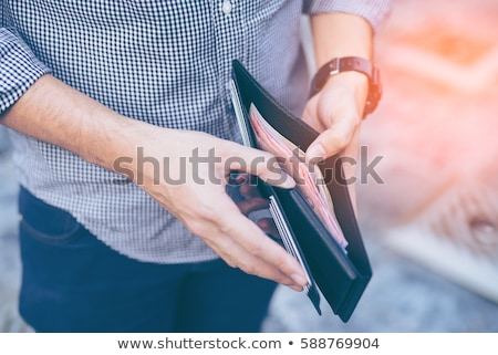Személyek kéz tart fekete pénztárca közelkép Stock fotó © AndreyPopov