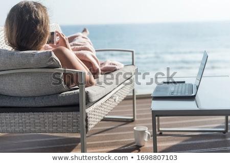 mooie · brunette · zomer · terras · zee · cafe - stockfoto © ElenaBatkova