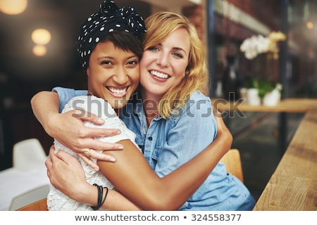 Csinos barátságos fiatal nő mosoly közelkép fej Stock fotó © Giulio_Fornasar