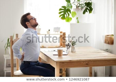 homem · dor · nas · costas · jovem · africano · sessão · sofá - foto stock © andreypopov