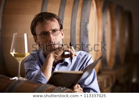 Wine producer contemplating in cellar. Stock photo © lichtmeister