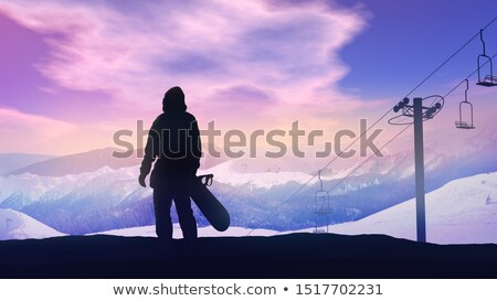 Snowboarder watching the sunset over the mountains. Stock photo © ConceptCafe