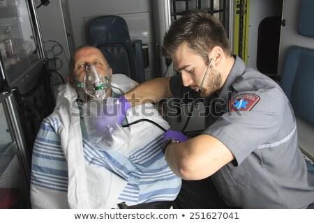 Equipo profesional inconsciente hombres primeros auxilios Foto stock © Lopolo