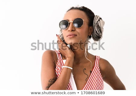 Concentrated amazing young girl with dreadlocks Stock photo © deandrobot