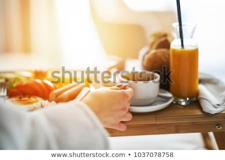 paar · eten · ontbijt · hotelkamer · man · gelukkig - stockfoto © photography33