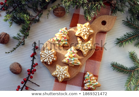snowflake shapes against tree lights stock photo © backyardproductions