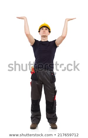 Stock photo: Man holding up a construction helmet