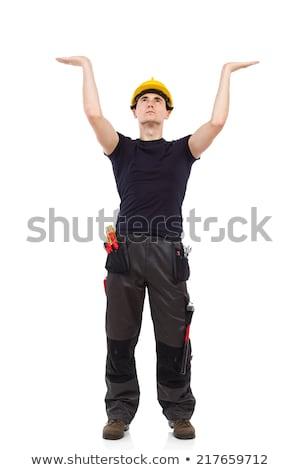 Man holding up a construction helmet Stock photo © photography33