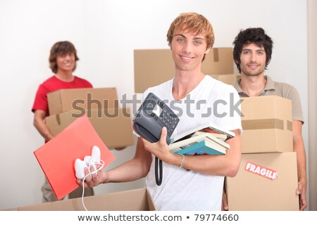 Stock photo: three housemates moving into new house