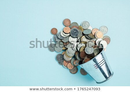 Bucket coins Stock photo © dengess