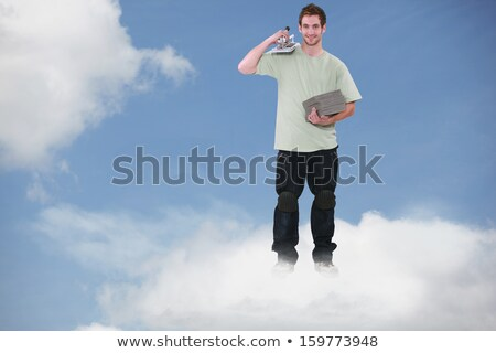 Montage of a smiling bricklayer standing on a cloud Stock photo © photography33