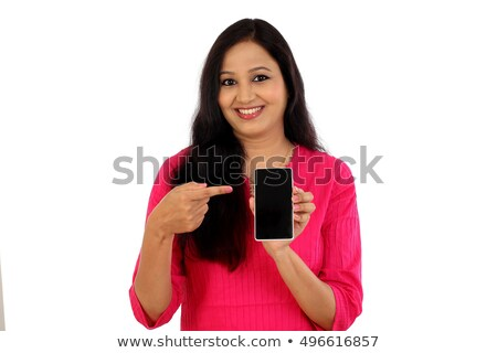 Woman showing a mobile phone against a white background Stock photo © wavebreak_media