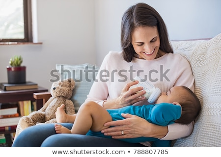 A cute little baby fed by her mother Stock photo © luckyraccoon