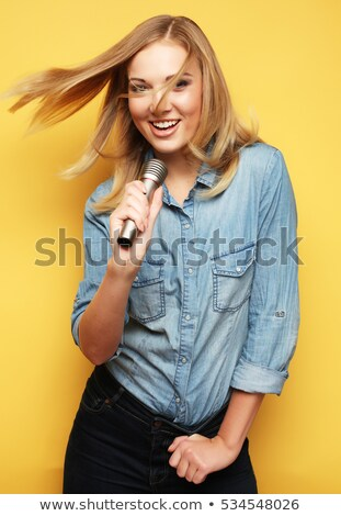 Portrait of girl holding mike Stock photo © zzve