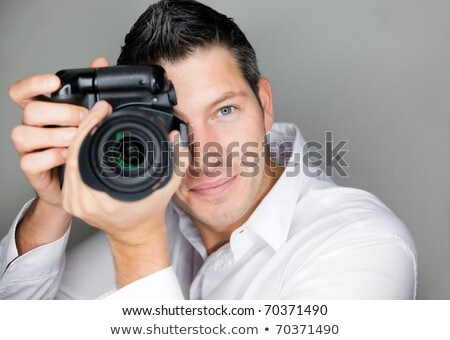 adult man photographer with digital camera dslr isolated Stock photo © juniart