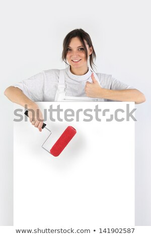 Female decorator with a board left blank for your message Stock photo © photography33