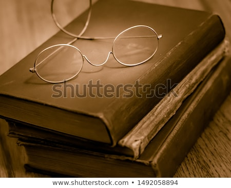 Stock photo: Glasses on vintage book.