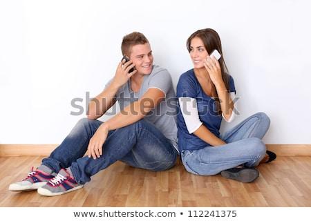 édes · lány · ül · beszél · mobiltelefon · kanapé - stock fotó © feelphotoart