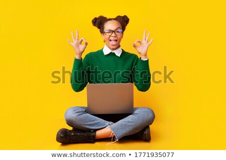 Happy african american college student with laptop and finger up Stock photo © vlad_star