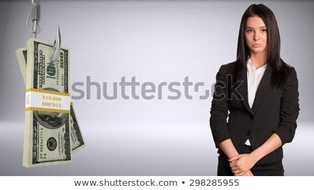 Sad businesslady looking at camera Stock photo © cherezoff