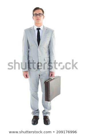молодые · бизнесмен · портфель · серый · счастливым - Сток-фото © wavebreak_media