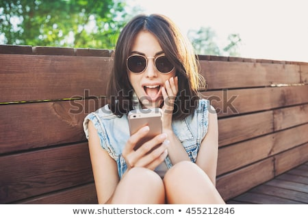 Young cool woman surprised Stock photo © Aikon