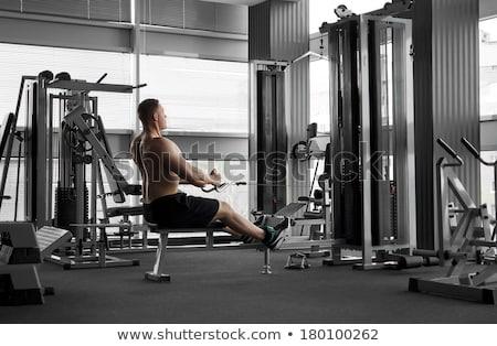 Athletic bodybuilder, execute exercise in sport gym hall Stock photo © zurijeta