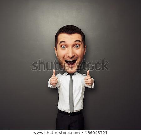 Glad young businessman showing thumb up Stock photo © NikoDzhi