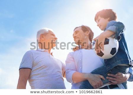 Ragazzo giocare calcio padre nipote giardino Foto d'archivio © wavebreak_media