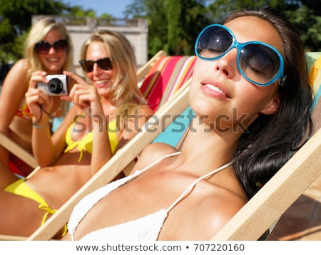 girlfriends around pool taking pictures stock photo © is2