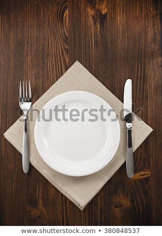Plate, knife and fork served on wooden table Stock photo © wavebreak_media