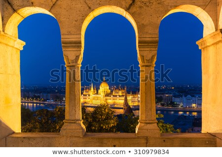Cityscape seen through arched window Stock photo © IS2