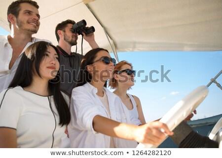 Man wearing sunglasses steering yacht Stock photo © IS2