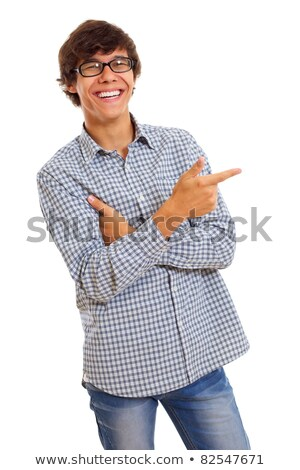 smiling man wearing checkered shirt and jeans standing Stock photo © feedough