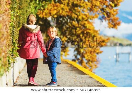 cheerful family enjoying great autumnal weather stock photo © konradbak